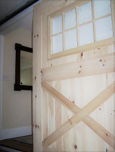 custom designed barn door for a home in Derry NH