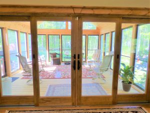 Sliding doors out to a indoor porch