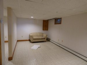 Before view of unfinished basement in Exeter NH